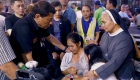 President Rodrigo Roa Duterte consoles the relatives of one of the victims who were trapped inside the NCCC Mall Davao upon hearing the news that their loved ones may have zero chance of survival as the fire inside the mall continues to rage as of dawn of December 24, 2017. Joining the President is Special Assistant to the President Christopher Lawrence Go. JOEY DALUMPINES/PRESIDENTIAL PHOTO